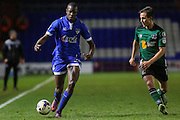 Ousmane Fané of Oldham Athletic runs at Scunthorpe United midfielder Josh Morris (11) during the EFL Sky Bet League 1 match between Oldham Athletic and Scunthorpe United at Boundary Park, Oldham, England on 18 October 2016. Photo by Simon Brady.