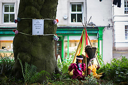 "© Licensed to London News Pictures. 26/06/2015. Settle, UK.  Picture shows Settle's very own ""wild Indians"" complete with washing line at Settle flower pot festival. The market town of Settle in the Yorkshire Dales is set to go flower pot mad over the weekend with the second Flower Pot Festival taking place. Locals in the town use the flower pots to make men, snakes, dogs, spiders & even a darlek.  Photo credit : Andrew McCaren/LNP"