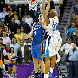 January 24,  2011; New Orleans, LA, USA; New Orleans Hornets power forward David West (30) shoots over Oklahoma City Thunder power forward Nick Collison (4) during the second half at the New Orleans Arena. The Hornets defeated the Thunder 91-89. Mandatory Credit: Derick E. Hingle