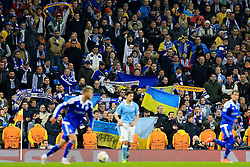 Dynamo Kiev fans hold up flags and scarves during play - Mandatory byline: Matt McNulty/JMP - 15/03/2016 - FOOTBALL - Etihad Stadium - Manchester, England - Manchester City v Dynamo Kyiv - Champions League - Round of 16