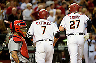 PHOENIX, ARIZONA - APRIL 27:  Brandon Drury #27 and Welington Castillo #7 of the Arizona Diamondbacks run back to the dugout after Drury hit a two run home run in the second inning against the St. Louis Cardinals at Chase Field on April 27, 2016 in Phoenix, Arizona.  (Photo by Jennifer Stewart/Getty Images)