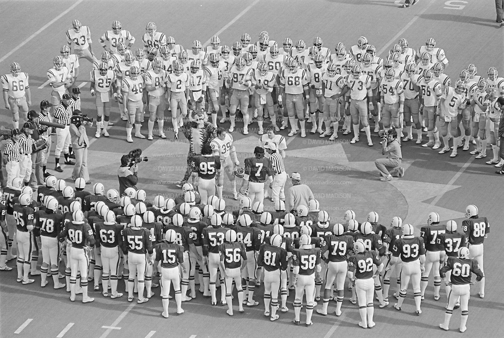 Coin toss at start of the 1977 Sun Bowl, Stanford v LSU, December 31, 1977 at Sun Bowl Stadium, University of Texas El Paso, El Paso, Texas.  Visible players include Guy Benjamin #7, Gordy Ceresino #95, Head Coach Bill Walsh, photographer Robbie Beyers.  Photograph by David Madison.