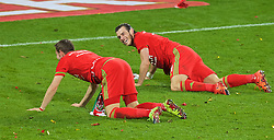 CARDIFF, WALES - Tuesday, October 13, 2015: Wales' Gareth Bale and Chris Gunter celebrates on the pitch after qualifying for the finals following a 2-0 victory over Andorra during the UEFA Euro 2016 qualifying Group B match at the Cardiff City Stadium. (Pic by Paul Currie/Propaganda)