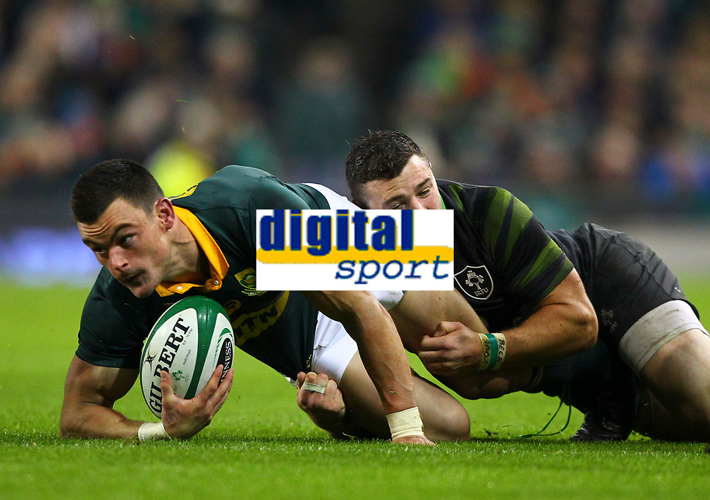 Rugby Union - 2017 Guinness Series (Autumn Internationals) - Ireland vs. South Africa<br /> <br /> South Africa's Jesse Kriel is tackled by Ireland's Robbie Henshaw, at the Aviva Stadium.<br /> <br /> COLORSPORT/KEN SUTTON