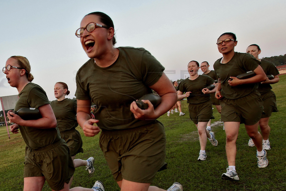 Female recruits yell as they swith stations in the physical preparation phase of their training.  Marine Corps Recruit Depot at Parris Island in South Carolina is where all male recruits living east of the Mississippi River and all female recruits from all over the US receive their arduous twelve week training in their quest to become marines. Even though there are two current active wars and a weak economy, recruitment has not been effected.  Actually, recruiting numbers have increased, with more young men and women looking toward the military for answers.