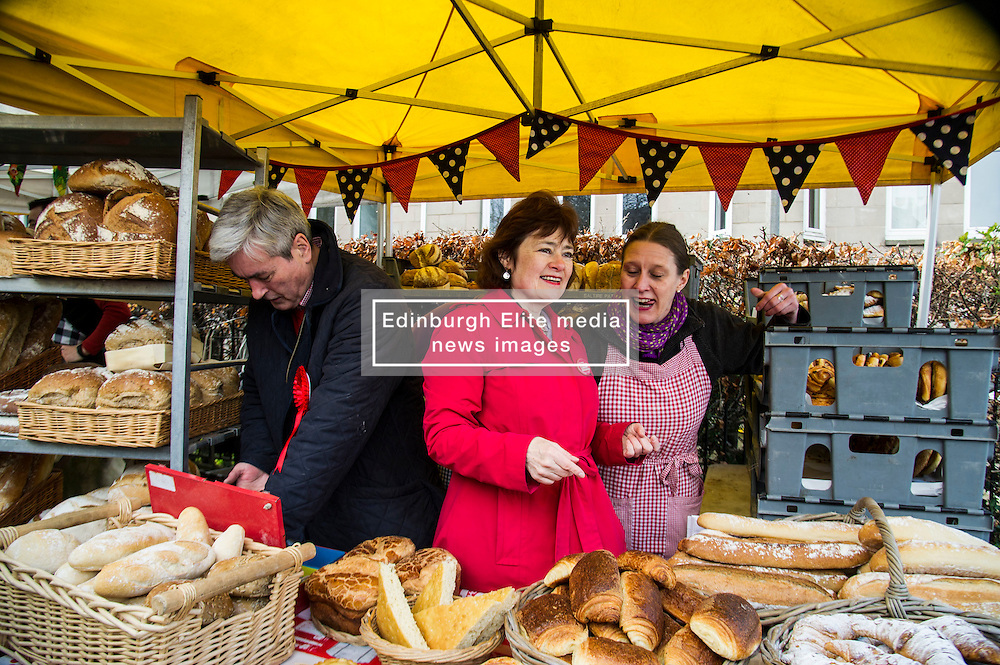 Pictured: Iain Gray and Sarah Boyack helped out at the Allgoument Bread stall under the watchful eye of owner Sara Roseburgh.<br /> <br /> The former Scottish Labour leader Iain Gray joined colleague Sarah Boyack activists and supporters at a street stall at Stockbridge Market. <br /> Ger Harley | EEm 10 April 2016