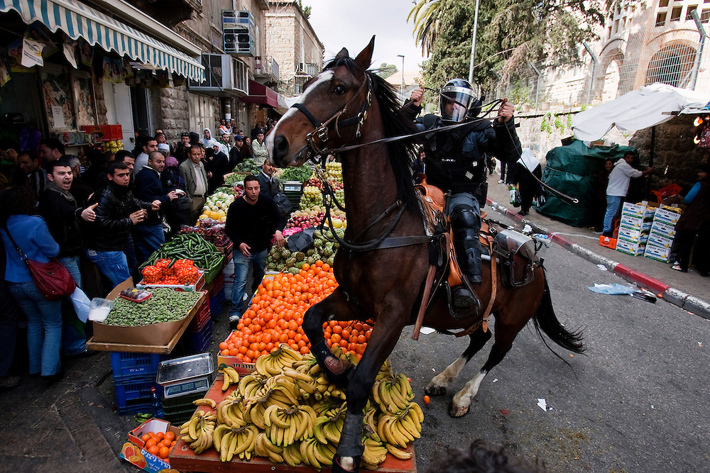 An Israeli mounted policeman disperses hundreds of Palestinian protesters during a demonstration marking Land Day in east Jerusalem on March 30, 2012.  2012. Israeli security forces in riot gear Friday confronted Palestinian demonstrators, anticipating possible clashes along Israel's frontiers on &quot;Land Day&quot;. The &quot;Land Day&quot; rallies are an annual event marked by Israeli Arabs and Palestinians in the West Bank and Gaza who protest what they say are discriminatory Israeli land policies.<br /> Photo by Olivier Fitousi / NEWS-PICTURES