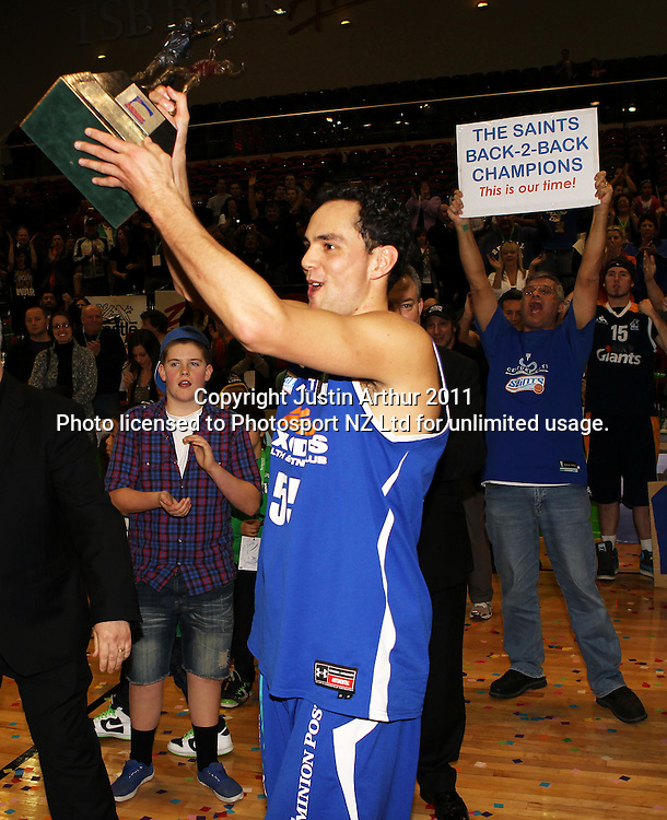 saints Troy McLean with the trophy. NBL Grand Final - Saints v Hawks at TSB Bank Arena Wellington, New Zealand on Sunday 17 July 2011. Photo: Justin Arthur/ photosport.co.nz
