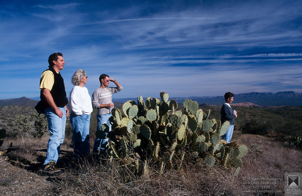 Hikers exploring the Arizona Trail with the Galiuro Mountains in background near Oracle, Arizona..Subject photograph(s) are copyright Edward McCain. All rights are reserved except those specifically granted by Edward McCain in writing prior to publication...McCain Photography.211 S 4th Avenue.Tucson, AZ 85701-2103.(520) 623-1998.mobile: (520) 990-0999.fax: (520) 623-1190.http://www.mccainphoto.com.edward@mccainphoto.com.