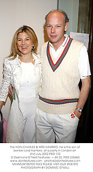 The HON.CHARLES & MRS HAMBRO, he is the son of banker Lord Hambro, at a party in London on 2nd July 2002.	PBO 102