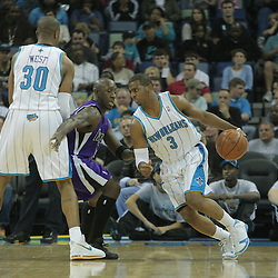 20 December 2008:  New Orleans Hornets guard Chris Paul (3) uses a pick by David West (30) to get around Sacramento Kings guard Bobby Jackson (24)during a NBA regular season game between the Sacramento Kings and the New Orleans Hornets at the New Orleans Arena in New Orleans, LA. .