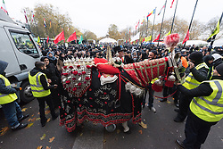 CAPTION CORRECTION © Licensed to London News Pictures. 20/11/2016. Muslims take part in the annual Arbaeen procession,  which marks a sacred Shia Muslim ritual. Arbaeen, also known as Chehlum, commemorates the end of the 40-day mourning period after the killing of Imam Hussein, the Prophet Muhammad's grandson, in a battle in 680 AD. His martyrdom is considered a defining event in the schism between Sunni and Shia Muslims. London, UK. Photo credit: Ray Tang/LNP