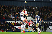 Southampton striker Shane Long (7) heads the ball under pressure from West Bromwich Albion defender (on loan from Al Ahly) Ahmed Hegazi (26) during the Premier League match between West Bromwich Albion and Southampton at The Hawthorns, West Bromwich, England on 3 February 2018. Picture by Dennis Goodwin.