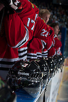 KELOWNA, CANADA - APRIL 18: The Portland Winterhawks stand on the bench during the national anthems against the Kelowna Rockets on April 18, 2014 during Game 1 of the third round of WHL Playoffs at Prospera Place in Kelowna, British Columbia, Canada.   (Photo by Marissa Baecker/Shoot the Breeze)  *** Local Caption *** Reebok; helmets; bench;