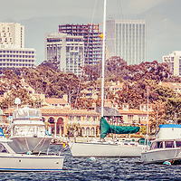 Newport Beach skyline panorama with vintage retro tone. Panoramic picture ratio is 1:3 and Includes boats in Newport Harbor (Newport Bay) with Newport Beach Fashion Island office buildings in the background.