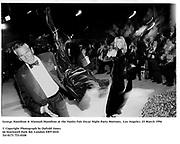 George Hamilton & Alannah Hamilton at the Vanity Fair Oscar Night Party Mortons,  Los Angeles. 25 March 1996<br /> <br /> © Copyright Photograph by Dafydd Jones<br /> 66 Stockwell Park Rd. London SW9 0DA<br /> Tel 0171 733 0108