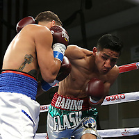 KISSIMMEE, FL - MARCH 06:  Gabino Cota (R) punches Jonathan Oquendo as they fight for the WBO Latino Flyweight Title during the Telemundo Boxeo boxing match at the Kissimmee Civic Center on March 6, 2015 in Kissimmee, Florida. Oquendo won the belt after a 10 round unanimous decision on the scorecards. (Photo by Alex Menendez/Getty Images) *** Local Caption *** Jonathan Oquendo; Gabino Cota