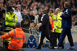 MANCHESTER, ENGLAND - Wednesday, March 24, 2010: Manchester City's manager Roberto Mancini is escorted off the pitch after being sent off by the refree during the Premiership match at the City of Manchester Stadium. (Photo by David Rawcliffe/Propaganda)