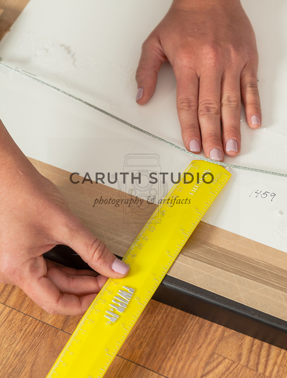 Measuring hanger placement to mark on kraft paper hanging template
