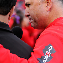"10 November 2012: Rutgers Scarlet Knights head coach Kyle Flood gives an interview with the Rutgers ""Strong"" logo raising awareness for Hurricane Sandy relief programs during NCAA college football action between the Rutgers Scarlet Knights and Army Black Knights at High Point Solutions Stadium in Piscataway, N.J.. Rutgers defeated Army 28-7."