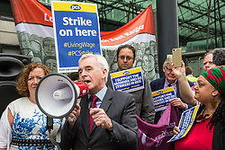 London, UK. 15 July, 2019. Shadow Chancellor John McDonnell addresses catering and cleaning staff belonging to the PCS trade union and outsourced to work at the Department for Business, Energy and Industrial Strategy (BEIS) via contractors ISS World and Aramark on the picket line outside the Government department after walking out on an indefinite strike for the London Living Wage, terms and conditions comparable to the civil servants they work alongside and an end to outsourcing.