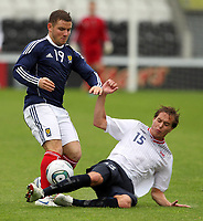 Fotball<br /> Skottland v Norge<br /> Foto: Colorsport/Digitalsport<br /> NORWAY ONLY<br /> <br /> Scotland vs Norway U21<br /> International Challenge Match, New St Mirren Park, Paisley.<br /> <br /> Alexander MacDonlad of Scotland Competes with Anders Konradsen of Norway <br /> <br /> 10th August 2011