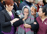 Agapita Montes-Rivera, 60, the mother of Antonio Zambano-Montes, center, is comforted following the funeral mass for her son Wednesday at St. Patrick Catholic Church in Pasco.