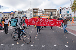 © Licensed to London News Pictures. 25/10/2018. Bristol, UK. Environmental group Extinction Rebellion stop Bristol traffic by holding a 20 minute disco in the city centre on Baldwin Street, to draw attention to the ecological crisis and climate breakdown. Police attended but there were no arrests. This latest action by the group is part of its escalating nationwide campaign to draw attention to the ecological crisis and climate breakdown, the group say using humorous, provocative and disruptive actions. Extinction Rebellion say that people need to know the severity of the climate catastrophe we are facing, that we are in the 6th mass species extinction and people are already dying, and that societal collapse and mass death are seen as inevitable by scientists and other credible voices, with human extinction also a possibility, if rapid action is not taken. Extinction Rebellion is coordinating a nonviolent uprising against what they say is criminal inaction by the British government on the climate emergency and ecological crisis. On 31st October, there will be a Declaration of Rebellion taking place in Parliament Square in London, with a series of disruptive actions planned from 12th November leading to Rebellion Day on 17th November​. The group's key demands are:<br /> The Government must tell the truth about the ecological emergency, reverse inconsistent policies and work alongside the media to communicate with citizens; The Government must enact legally binding policy measures to reduce carbon emissions to net zero by 2025 and to reduce consumption levels; A national Citizen's Assembly to oversee the changes, as part of creating a democracy fit for purpose. Photo credit: Simon Chapman/LNP