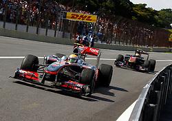 Motorsports / Formula 1: World Championship 2010, GP of Brazil, 02 Lewis Hamilton (GBR, Vodafone McLaren Mercedes), 17 Jaime Alguersuari (ESP, Scuderia Toro Rosso),