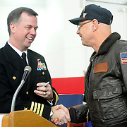 2/7/11 -- BRUNSWICK, Maine.  U.S. Navy Capt. William Fitzgerald, Commanding Officer of NAS Brunswick, lef, chats with retired Chief Petty Officer Dennis Carroll at the transfer ceremony of Hangar 6 today. The U. S. Navy passed Hangar 6 over to the Midcoast Regional Redevelopment Authority today in a ceremony attended by Maine Governor Paul LePage, Congresswoman Chellie Pingree and a host of other members of local and state government. Photo by MCC Roger S. Duncan.