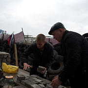 Pro-Russia activists gather paving stones outside the Donbass Regional Government building in central Donetsk. Barricades around the building, occupied since the past weekend, have been fortified throughout the day, as the ultimatum given by the government in Kiev for the activists to abandon the building within 48 hours, is approaching its deadline.