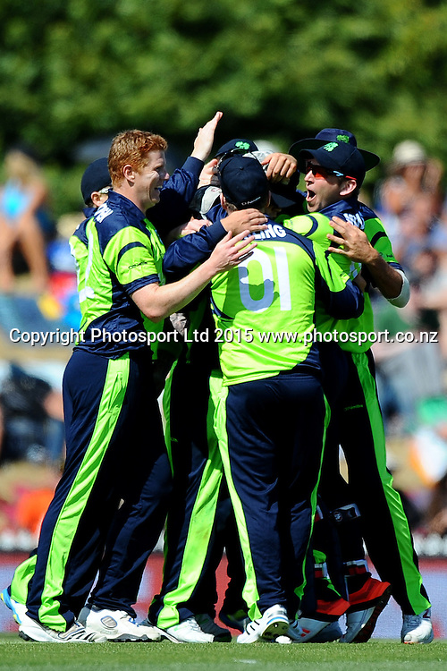 Ireland player celebrate the wicket of Chris Gayle during the 2015 ICC Cricket World Cup match between West Indies and Ireland. Saxton Oval, Nelson, New Zealand. Monday 16 February 2015. Copyright Photo: Chris Symes / www.photosport.co.nz