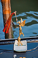 Detail of a golden angel patron with a banner on a gondola in Venice, Italy.
