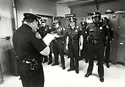 An understaffed Atlanta police force was constantly on the lookout for suspicious persons during the series of murders, Here, at a precinct roll call, officers are read the latest intellicence and tips from the public about the Atlanta Child Murders. Police were given so many differing tips from the public about the description of the Atlanta Child Murderer(s) that they didn't know if they were dealing with a single person or a group, white or black.