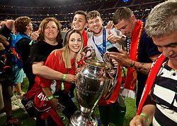 MADRID, SPAIN - SATURDAY, JUNE 1, 2019: Liverpool's Alberto Moreno and family with the trophy after the UEFA Champions League Final match between Tottenham Hotspur FC and Liverpool FC at the Estadio Metropolitano. Liverpool won 2-0 to win their sixth European Cup. (Pic by David Rawcliffe/Propaganda)