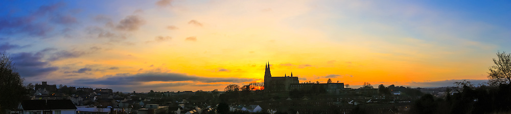 Sunset overlooking Armagh from Infinity Hill in Armagh Observatory Astropark including the Catholic and Protestant St. Patrick's Cathedrals.