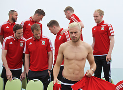 DINARD, FRANCE - Tuesday, June 7, 2016: Wales' Aaron Ramsey swaps shirts as players prepare for a team group photograph at the Novotel Thalasso Dinard ahead of the start of the UEFA Euro 2016 tournament. (Pic by Paul Greenwood/Propaganda)