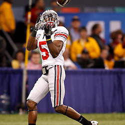January 4, 2011; New Orleans, LA, USA;  Ohio State Buckeyes wide receiver Taurian Washington (5) during warm ups prior to kickoff of the 2011 Sugar Bowl against the Arkansas Razorbacks at the Louisiana Superdome.  Mandatory Credit: Derick E. Hingle