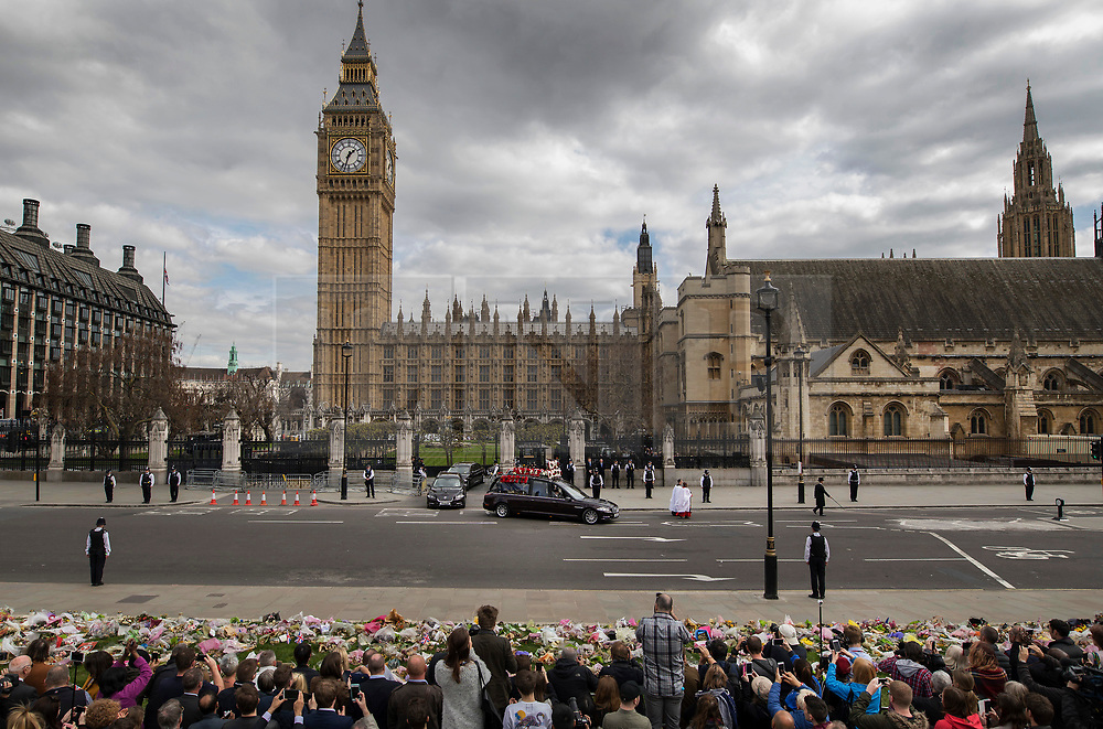 © Licensed to London News Pictures. 10/04/2017. London, UK. The funeral cortege carrying the coffin of policeman Keith Palmer leaves the Palace of Westminster through Carriage Gate. PC Palmer was murdered just inside the gate by Westminster attacker Khalid Masood - an attack in which he also killed four people on Westminster Bridge. PC Palmer's funeral will take place at Southwark Cathedral today. Photo credit: Peter Macdiarmid/LNP