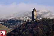 The first snows to hit the hills of Scotland in 2015, behind the Wallace Monument <br /> <br /> &copy; PRESS ASSOCIATION