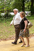 North Charleston Mayor Keith Summey arrives with his wife Judge Deborah Summey for a peace vigil lead by Rev. Al Sharpton to begin on the spot where unarmed motorist Walter Scott was gunned down by police April 12, 2015 in North Charleston, South Carolina. About 100 people showed up for the brief vigil following a healing service at Charity Mission Baptist Church.