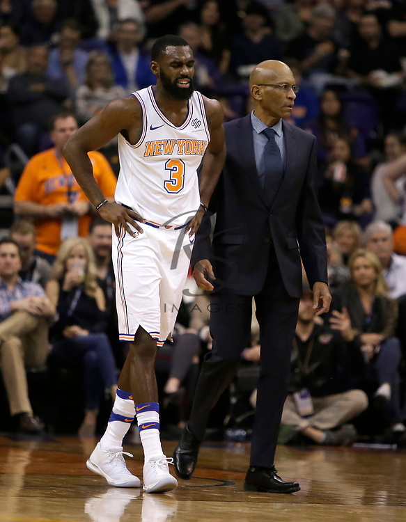 New York Knicks forward Tim Hardaway Jr. (3) gets helped off the court in the second half during an NBA basketball game against the Phoenix Suns, Friday, Jan. 26, 2018, in Phoenix. Hardaway Jr. never came back to the game as the Knicks defeated the Suns 107-85. (AP Photo/Rick Scuteri)