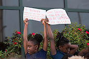 Young girls hold a sign during a vigil outside the North Charleston City Hall following the shooting death of Walter Scott April 10, 2015 in Charleston, South Carolina. Scott was shot multiple times by police after running from a traffic stop.
