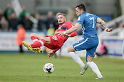 Nathan Thomas (Hartlepool United) and Gary Liddle (Carlisle United) collide in midfield , with Nathan Thomas (Hartlepool United) keeping his feet and controlling the ball during the EFL Sky Bet League 2 match between Hartlepool United and Carlisle United at Victoria Park, Hartlepool, England on 14 April 2017. Photo by Mark P Doherty.
