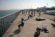 young boy fishing with his family Yokosuka Japan