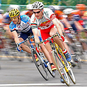 Auburn, NY / 2004 - (From left) Dave Taylor, from New York City and Matthew Dickinson from Watertown, NY, participate in the Prison City Downtown Criterium bicycle race in Auburn. Dickinson placed 4th in this race, while Taylor placed 24th. Photo by Mike Roy / For The Syracuse Post-Standard