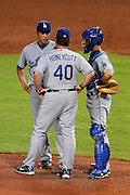 ATLANTA - AUGUST 13:  Pitching coach Rick Honeycutt #40 of the Los Angeles Dodgers talks with pitcher Hiroki Kuroda #18 (L) while catcher Brad Ausmus #12 (R) looks on during the game against the Atlanta Braves at Turner Field on August 13, 2010 in Atlanta, Georgia.  The Braves beat the Dodgers 1-0.  (Photo by Mike Zarrilli/Getty Images)