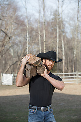 cowboy carrying firewood