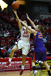 01 January 2012:  Alison Seberger takes a shot and gets hacked by Samantha Heck during an NCAA women's basketball game between the Evansville Purple Aces and the Illinois Sate Redbirds at Redbird Arena in Normal IL