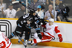 May 1, 2011; San Jose, CA, USA;  San Jose Sharks right wing Ryane Clowe (29) check Detroit Red Wings defenseman Brian Rafalski (28) during the second period of game two of the western conference semifinals of the 2011 Stanley Cup playoffs at HP Pavilion. San Jose defeated Detroit 2-1. Mandatory Credit: Jason O. Watson / US PRESSWIRE